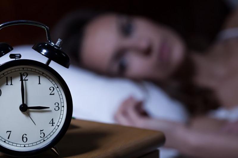 depositphotos_60092493-stock-photo-alarm-clock-on-night-table